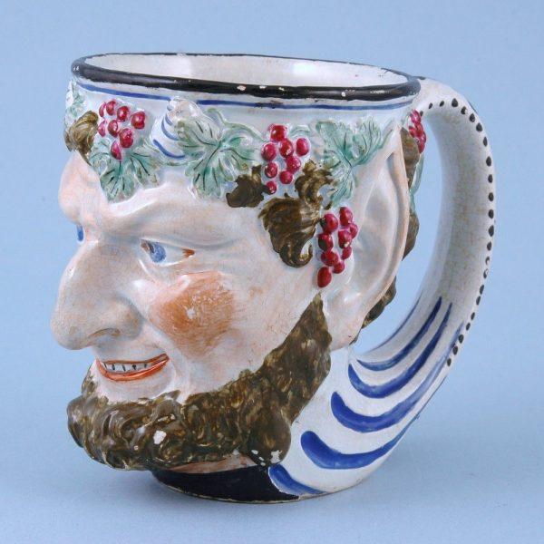 Staffordshire Pottery Satyr/Bacchus mug.