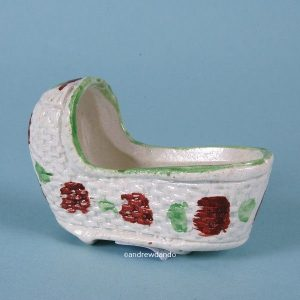 Staffordshire Pottery Miniature Cradle.