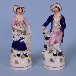 Pair of Staffordshire Porcelain Figures of Shepherd & Shepherdess
