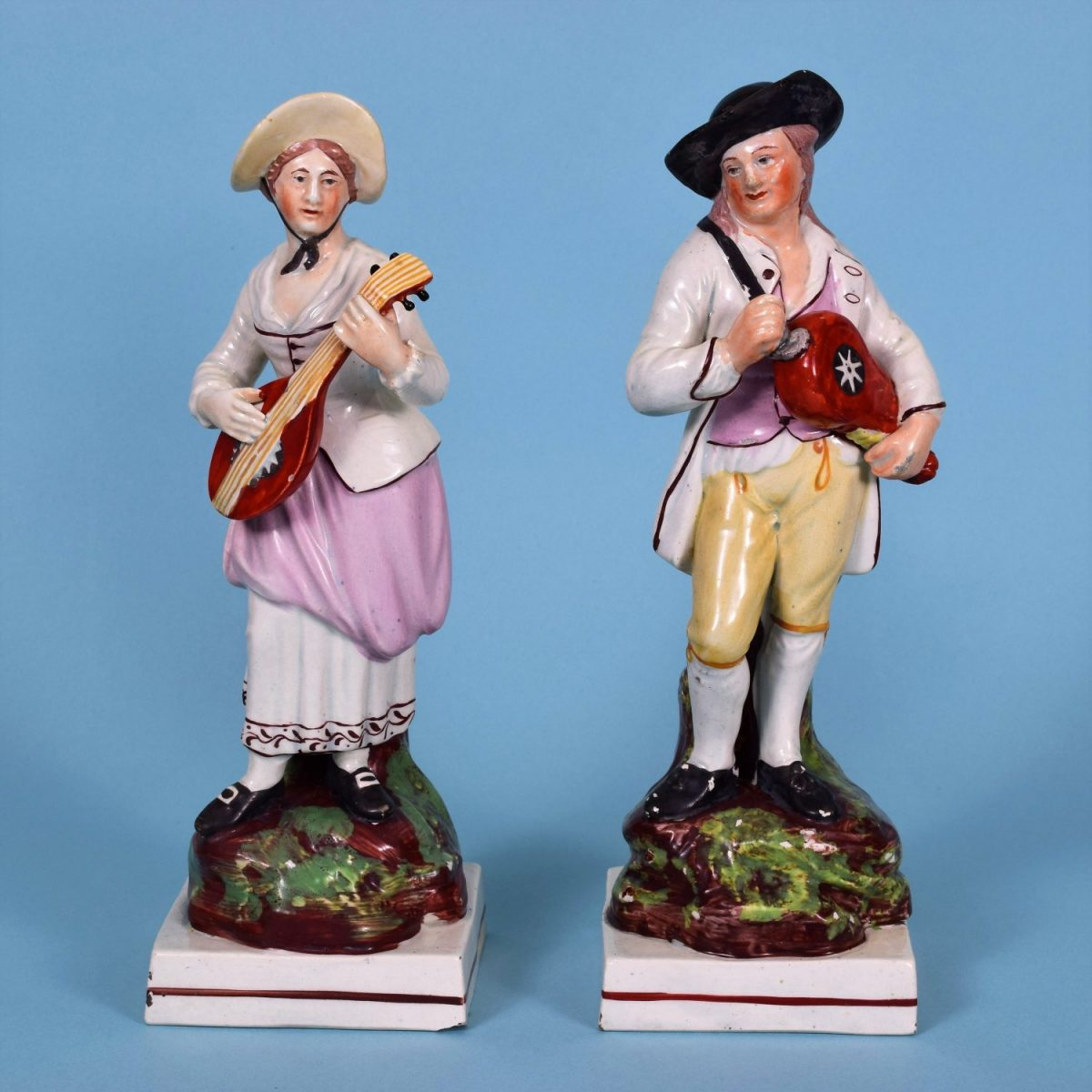 Pair of Staffordshire Pottery Flemish Music Figures.