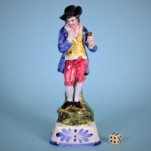 Unusual Pottery Figure of a Man Drinking