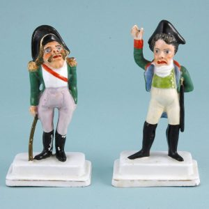Unusual pair of Staffordshire military caricature figures