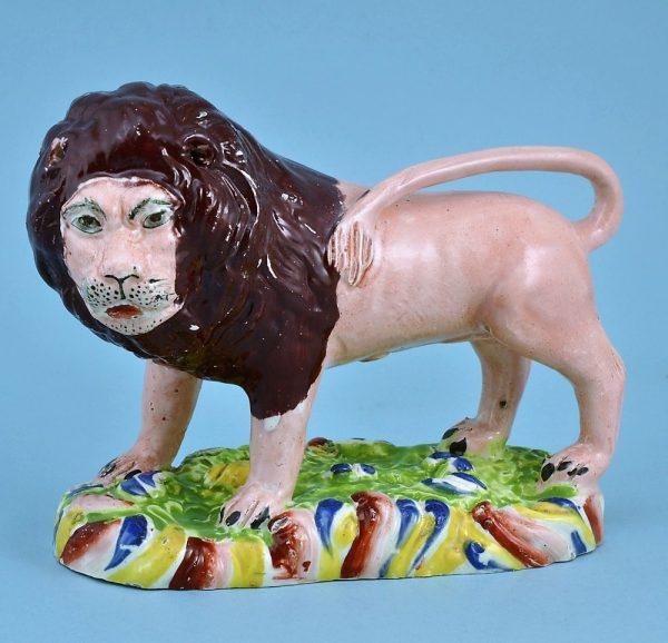 Staffordshire Pottery Lion with Rainbow Coloured Base
