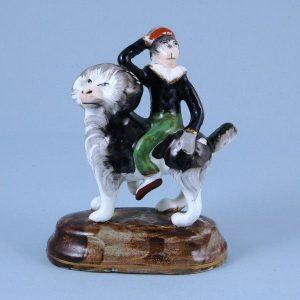 Antique Staffordshire porcelain Monkey riding a Dog