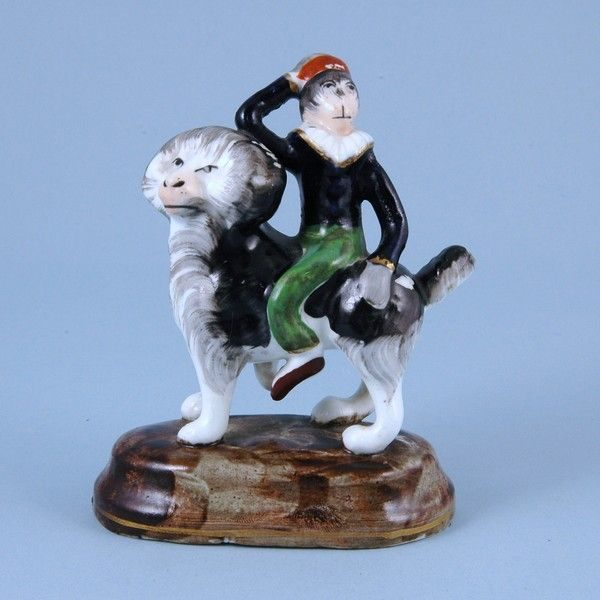 Antique Staffordshire porcelain Monkey riding a Dog