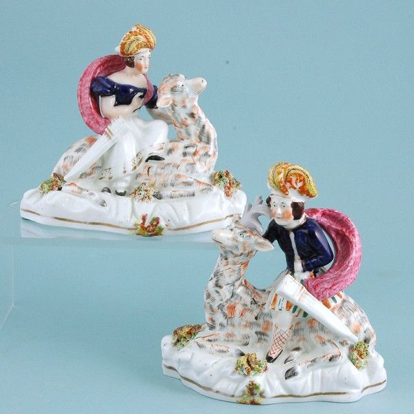 Pair of Staffordshire Royal Children riding Deer. (🟢)