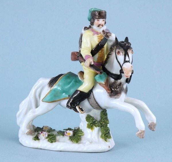 Meissen miniature figure of a Polish Hussar on horseback