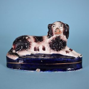 Staffordshire Spaniel on blue base.