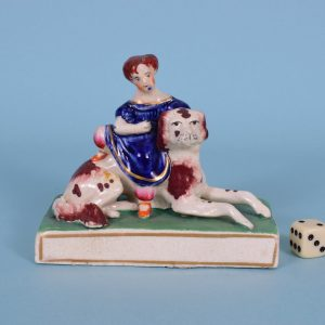Staffordshire Girl Sitting on a Dog.