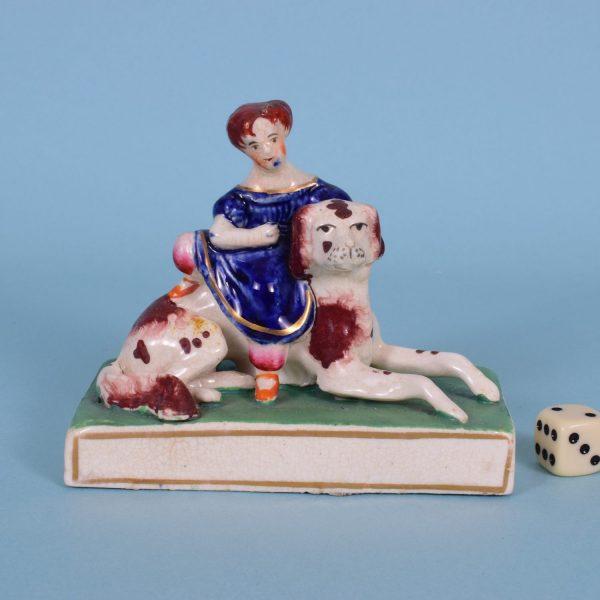 Staffordshire Girl Sitting on a Dog.