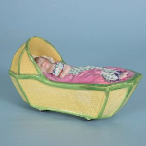 Staffordshire Pottery Cradle With Child