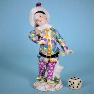 Meissen Figure of a Child Dressed as Harlequin