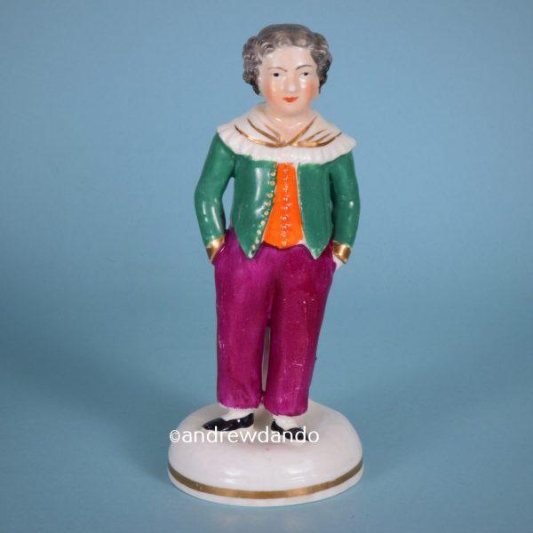 Staffordshire Porcelain Figure of a Boy.