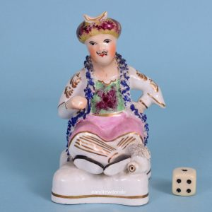 Staffordshire Porcelain Seated Figure of a Turk.