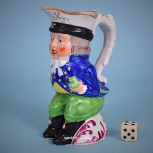 Staffordshire 'Paul Pry' Toby Jug.