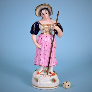 Staffordshire Figure of a Girl Holding a Rake.