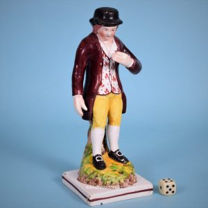 Staffordshire Figure of a Boy.