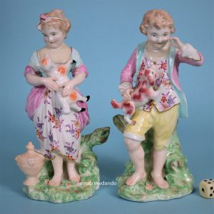 Pair of Chelsea Derby Figures of Children.
