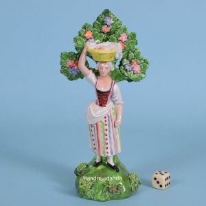 Staffordshire Figure of a Girl Carrying a Basket.