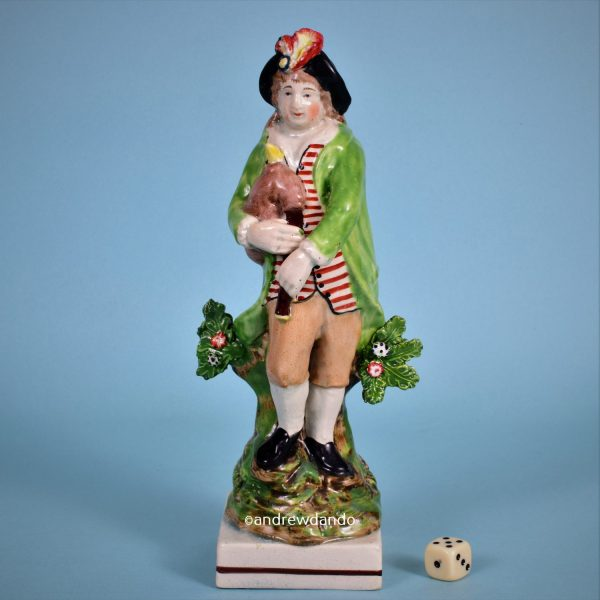 Staffordshire Figure of a Bagpiper