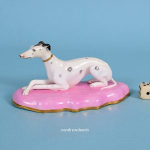 English Porcelain Whippet on a Pink Base.