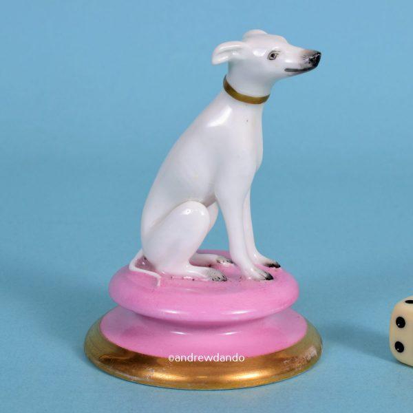 English Porcelain Dog on Pink Circular Base.