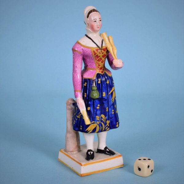 Staffordshire Figure of a Broom Seller.