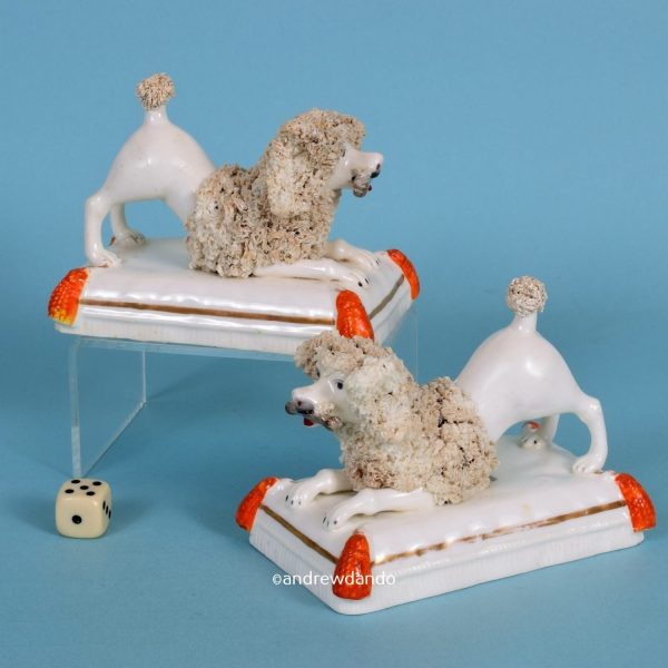 Pair of Staffordshire Crouching Poodles.