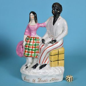 Staffordshire Figure of Uncle Tom and Eva.