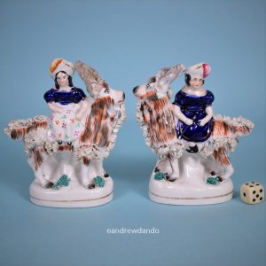 Pair of Staffordshire Children Riding Goats