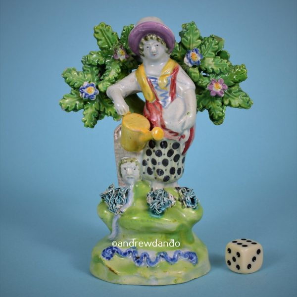 Staffordshire Pottery Figure of a Female Gardener.