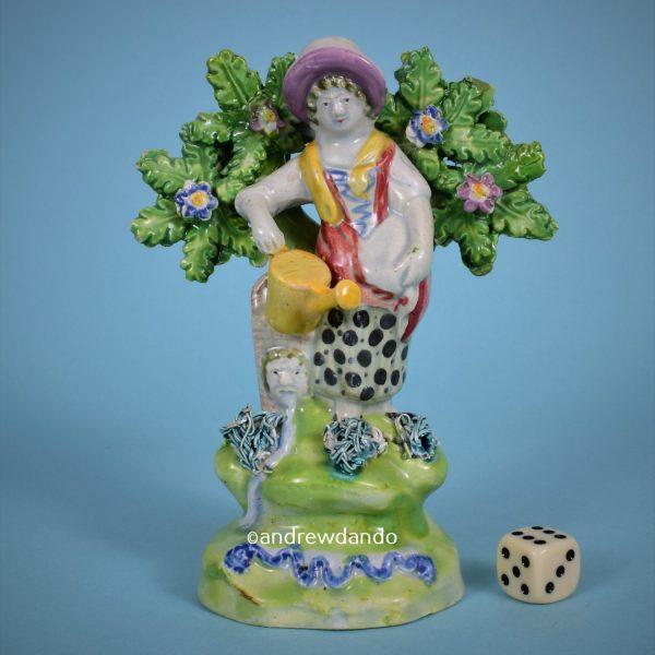 Staffordshire Pottery Figure of a Female Gardener.