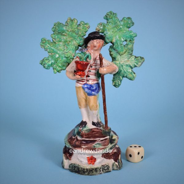 Staffordshire Pottery Figure of a Gardener.