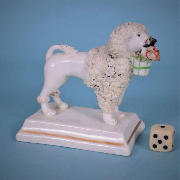 Staffordshire Poodle with basket.