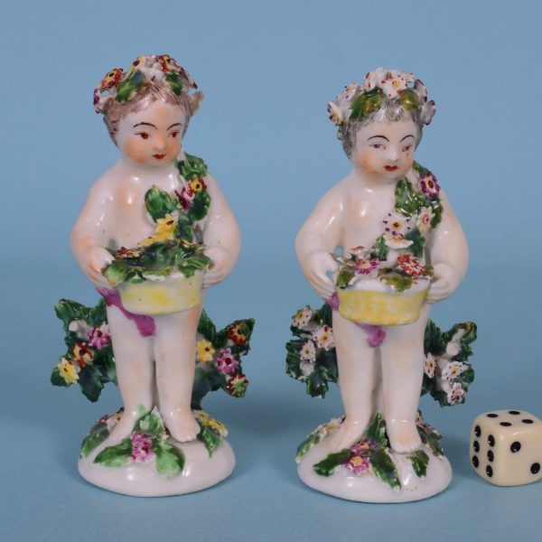Two Derby Putto Figures.