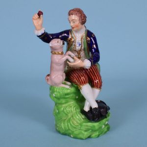 Derby Figure of a Man with a Pug Dog
