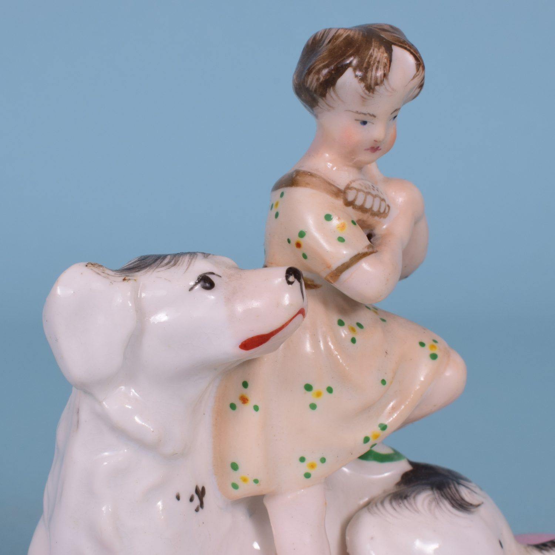Staffordshire Porcelain Girl Sitting on a Dog.