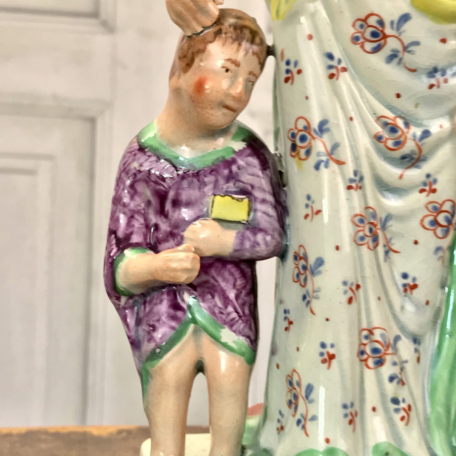 Early C19th Staffordshire Figure of Charity.