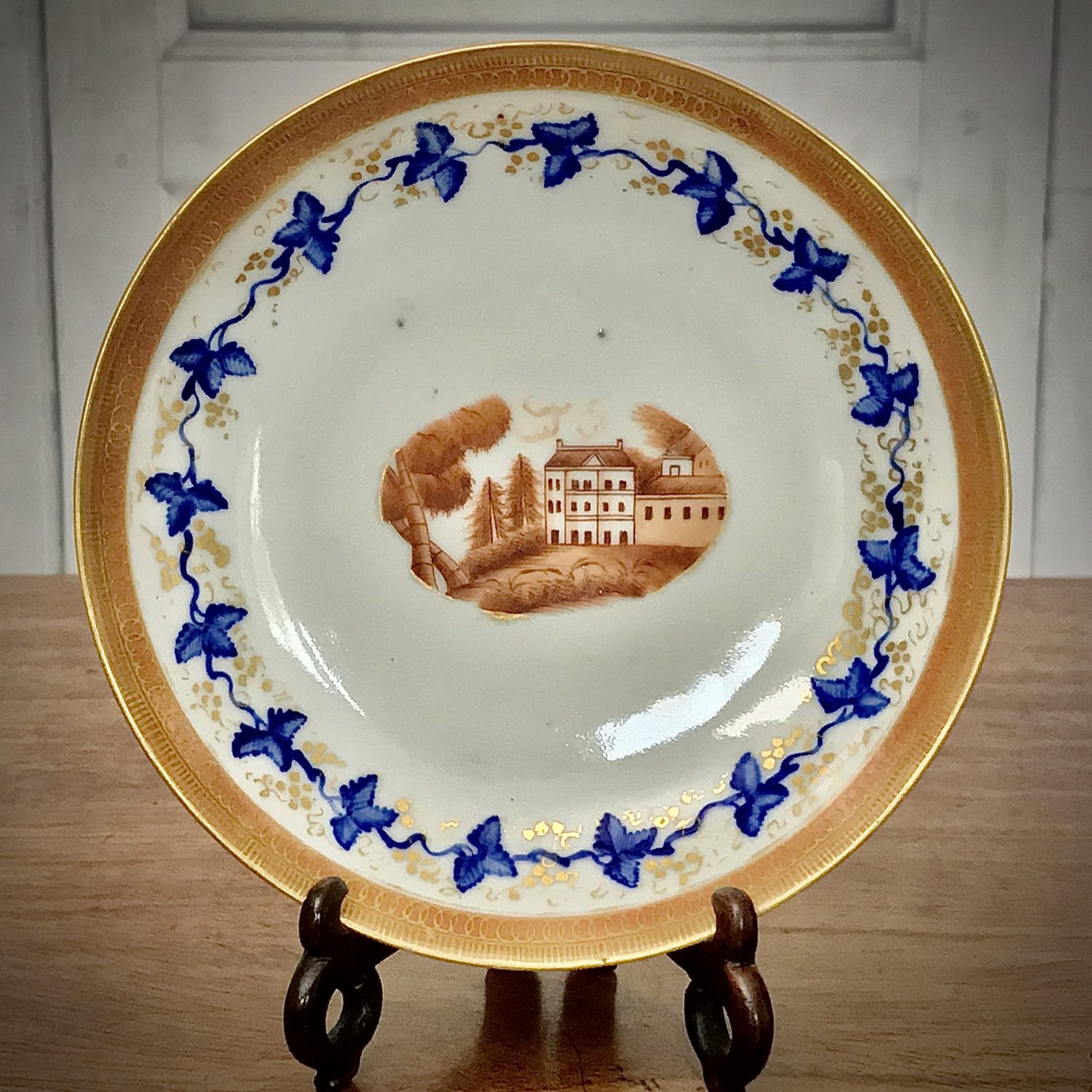 Chinese Export Porcelain Saucer With Country House Scene.