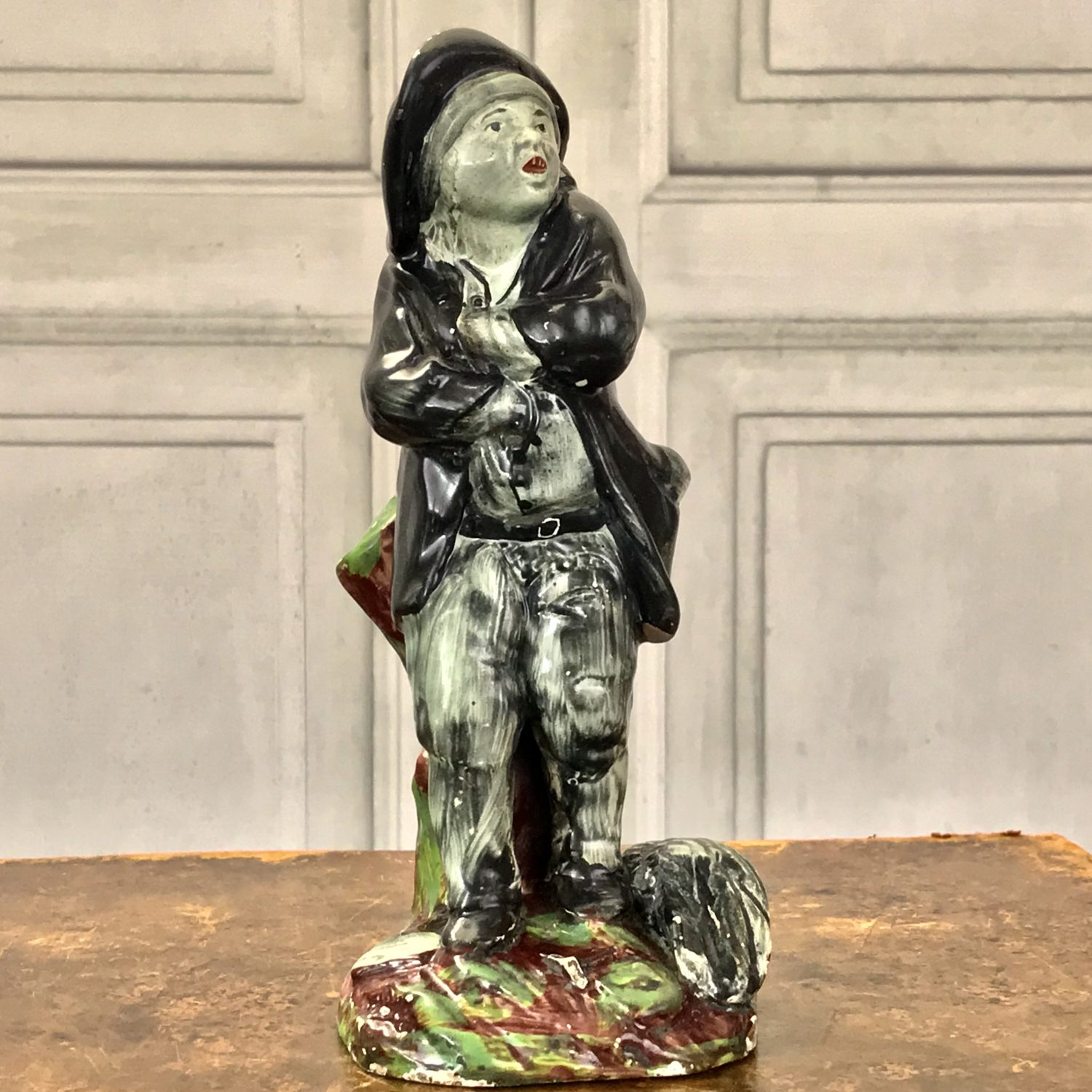Early C19th Staffordshire Figure of a Chimney Sweep.