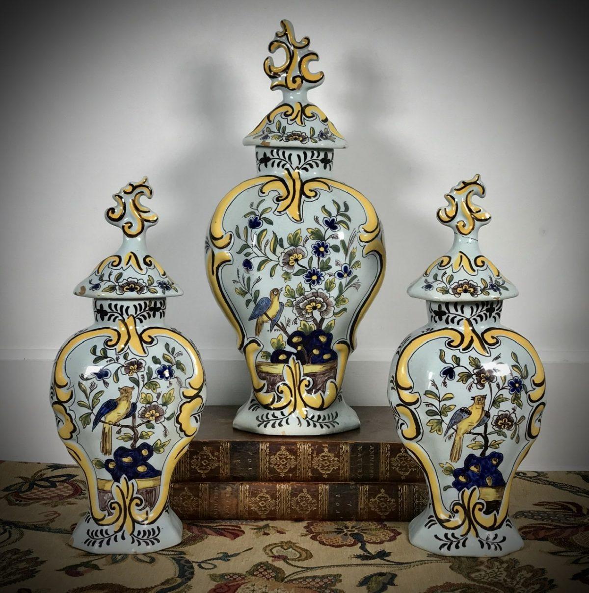 Garniture of Dutch Delft Vases & Covers.