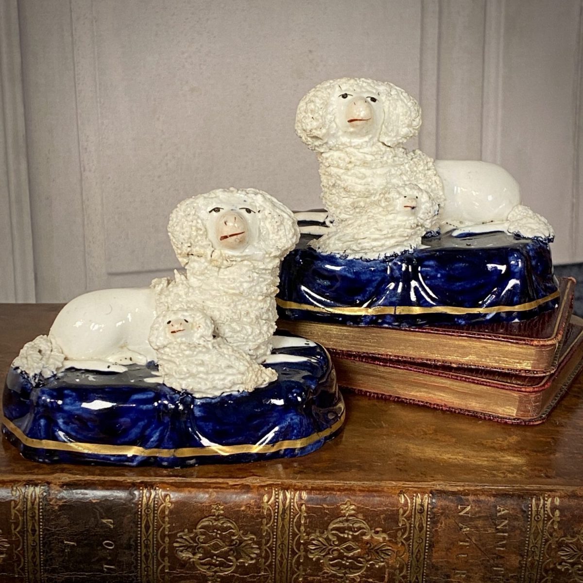 Pair of Staffordshire Poodles & Puppies on Blue Bases.