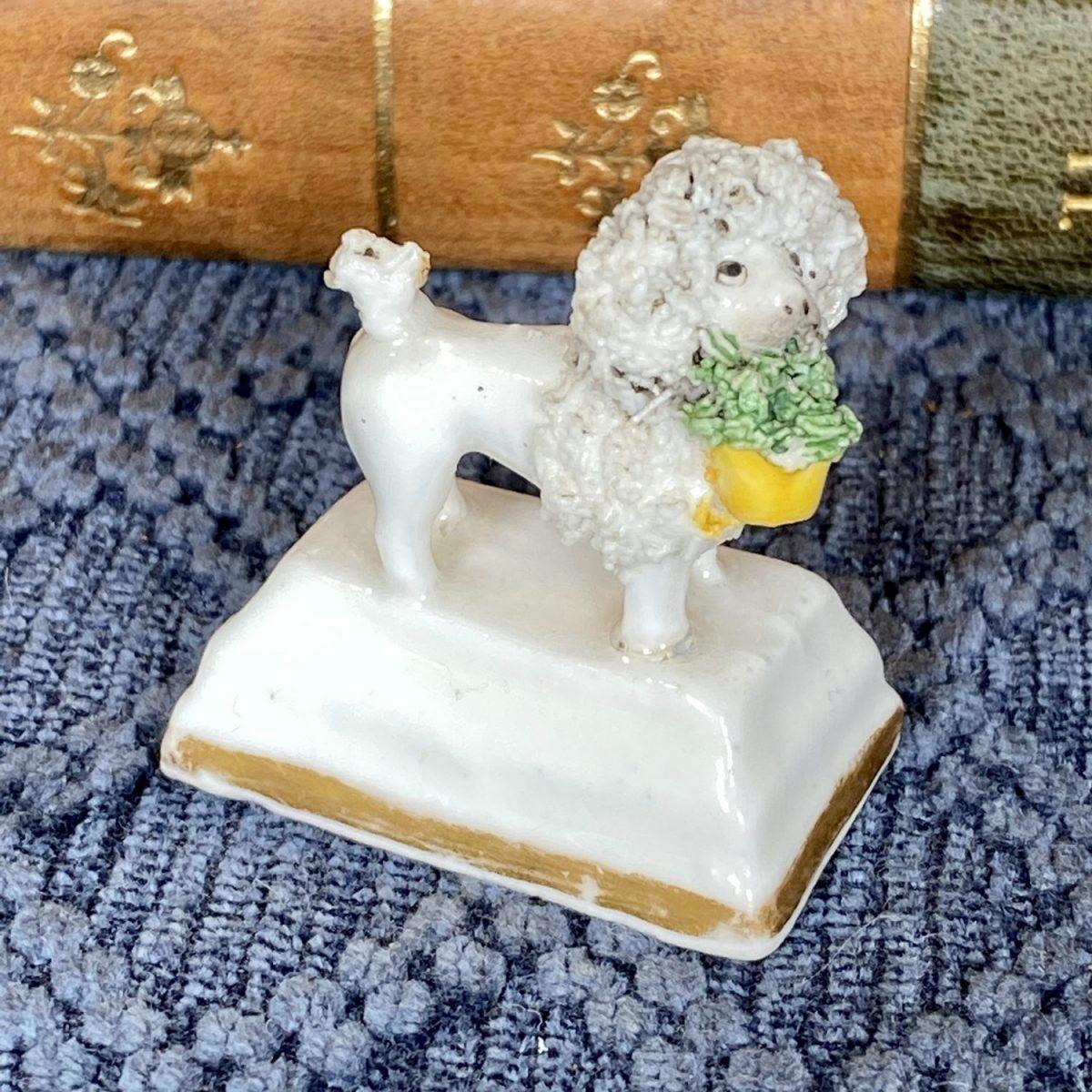 C19th Staffordshire Porcelain Miniature Poodle Holding a Basket
