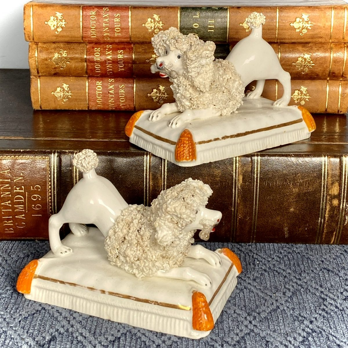 Pair of C19th Staffordshire Porcelain Crouching Poodles.