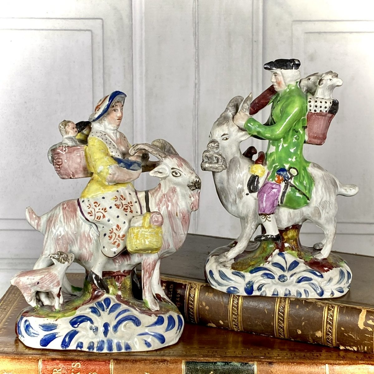 Pair of Staffordshire Pottery 'Welch Tailor & Wife Riding Goats', c1830.