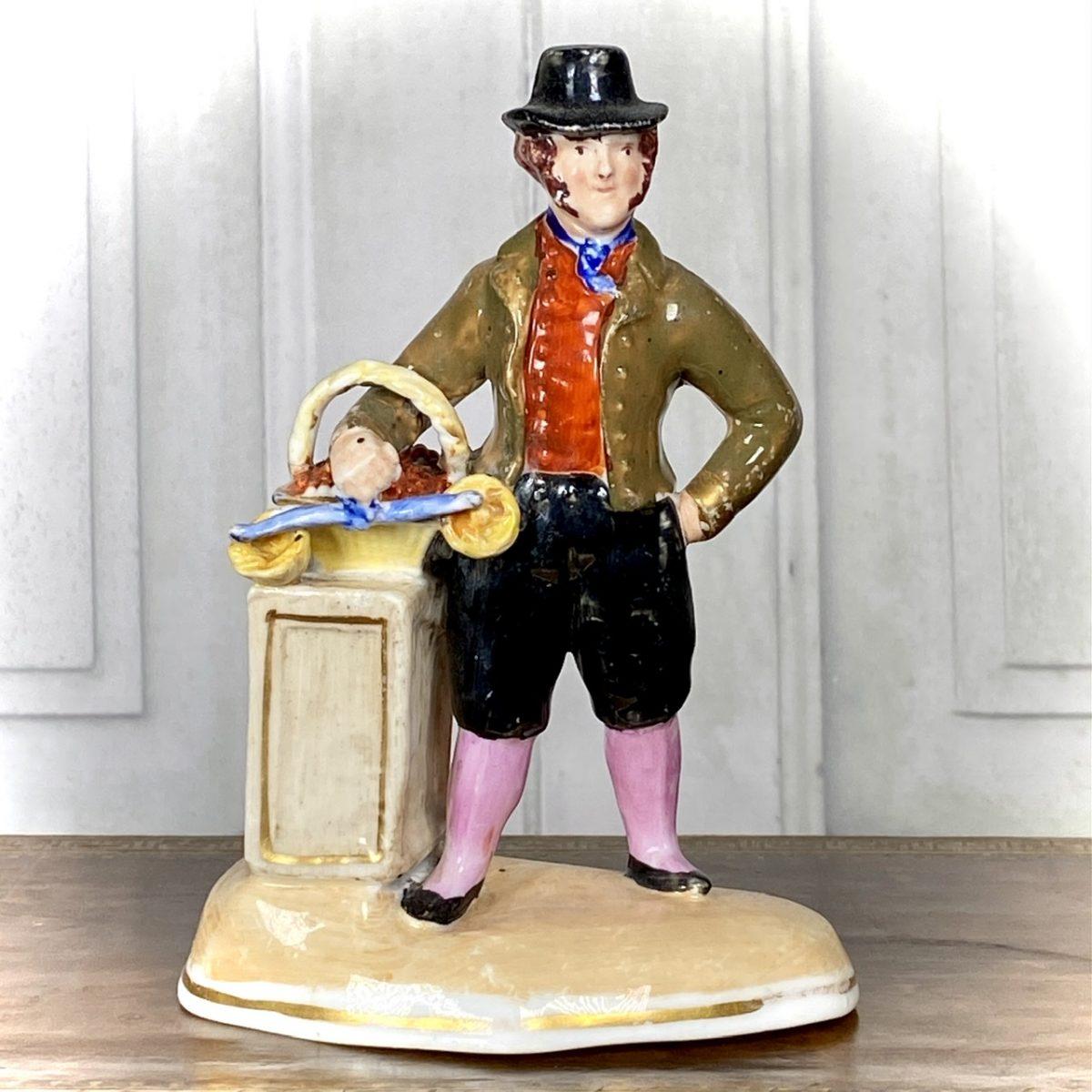 C19th Staffordshire Porcelain Figure of a Fruit Seller.