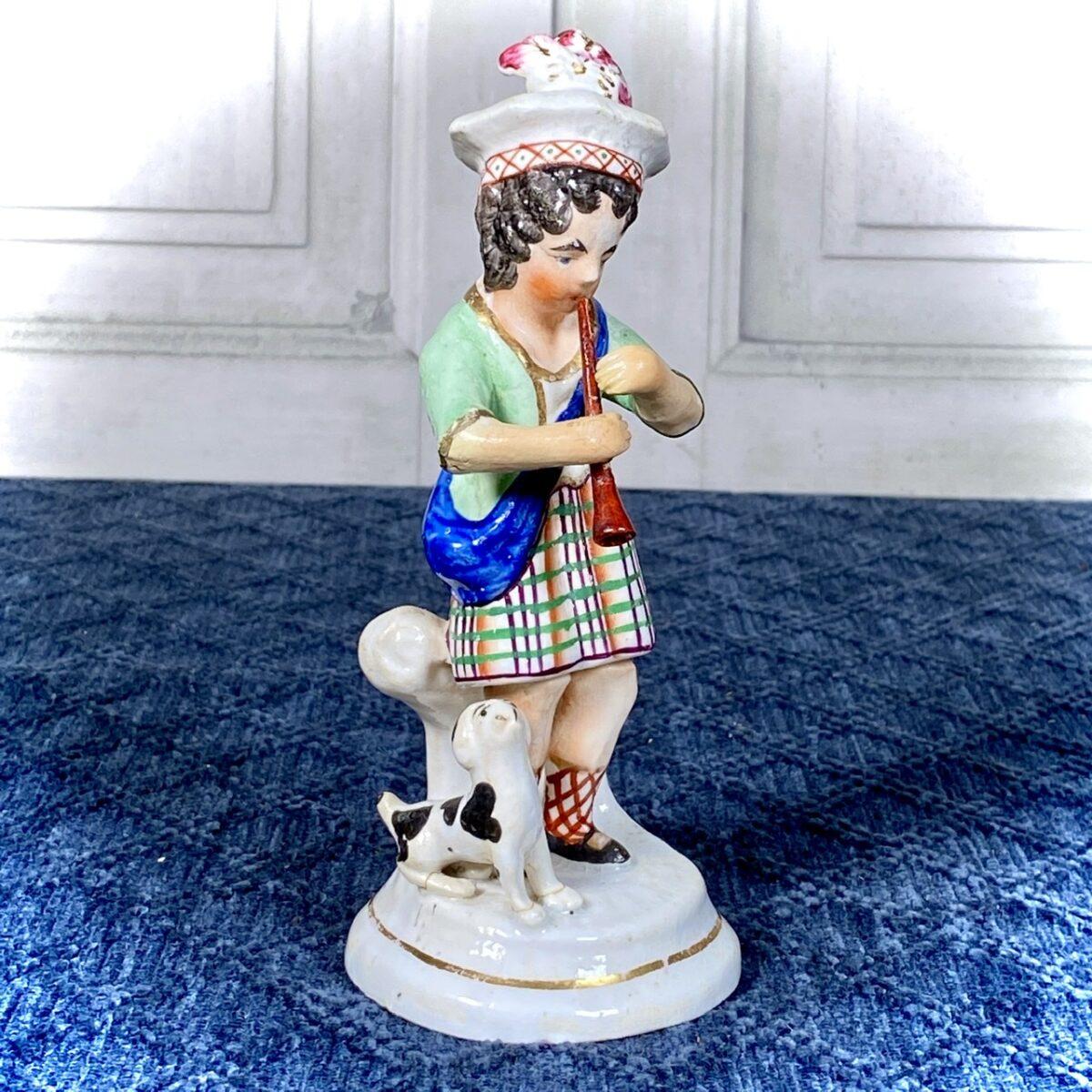 Staffordshire Porcelain Figure of a Boy Piper (af)